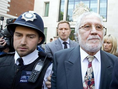 Former Radio 1 DJ, Dave Lee Travis, real name David Patrick Griffin, leaves after appearing at Westminster magistrates' court in London Augu