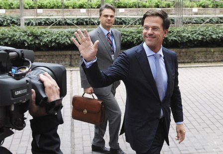 Netherlands' Prime Minister Mark Rutte waves as he arrives at a European Union leaders summit in Brussels June 27, 2013. REUTERS/Laurent Dub
