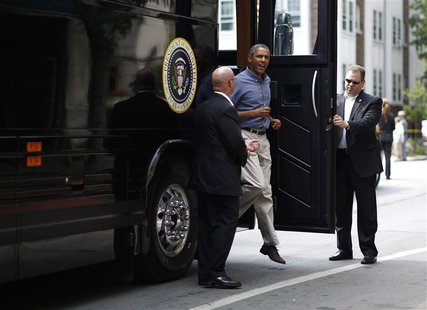 U.S. President Barack Obama steps off his bus at Magnolia's Deli and Cafe in Rochester, New York, August 22, 2013. REUTERS/Jason Reed