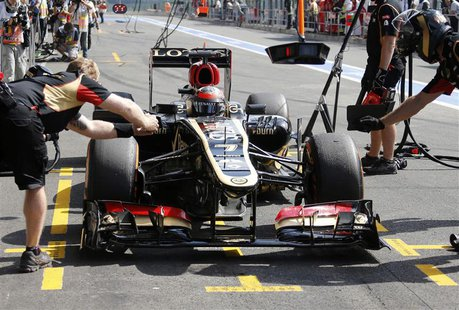 Lotus Formula One driver Kimi Raikkonen of Finland drives into the pit during the second practice session of the Belgian F1 Grand Prix at th