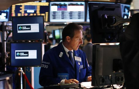 A trader works on the main trading floor of the New York Stock Exchange (NYSE) shortly after the opening bell in New York, May 20, 2013. REU