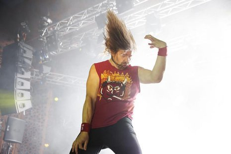 "Winner Eric ""Mean Melin"" Melin of the U.S. performs during the 2013 Air Guitar World Championships in Oulu August 23, 2013. REUTERS/Timo Hei"