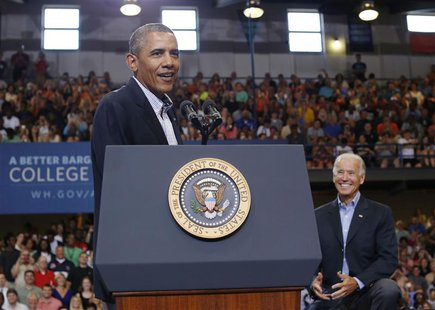 U.S. President Barack Obama delivers remarks alongside Vice President Joe Biden at Lackawanna College in Biden's home town of Scranton, Penn