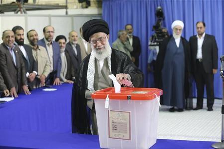 Iran's Supreme Leader Ayatollah Ali Khamenei casts his ballot at his office during the Iranian presidential election in central Tehran June 14, 2013. Credit: Reuters/Fars News/Hassan Mousavi