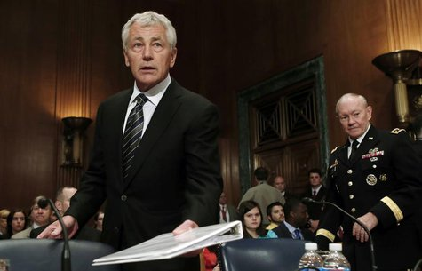 Defense Secretary Chuck Hagel (L) and U.S. Joint Chiefs Chairman General Martin Dempsey arrive to testify at a Senate Appropriations Defense