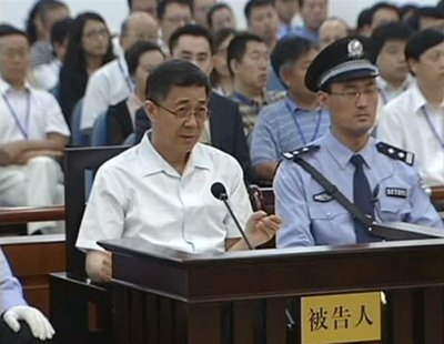 Bo Xilai (L), former Communist Party chief of the southwestern city of Chongqing, speaks during his trial in Jinan, Shandong province, Augus