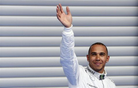 Mercedes Formula One driver Lewis Hamilton of Britain waves as he celebrates taking pole position after the qualifying session for the Belgi