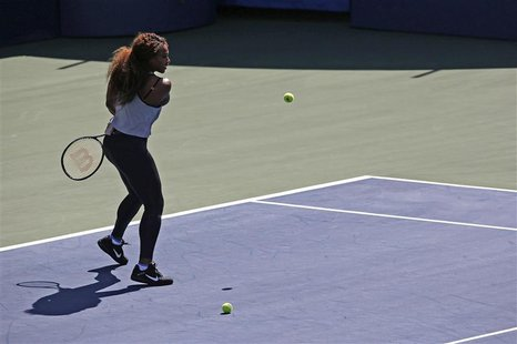 Reigning U.S. Open champion Serena Williams participates in a skills competition during Arthur Ashe Kids' Day at the USTA Billie Jean King N