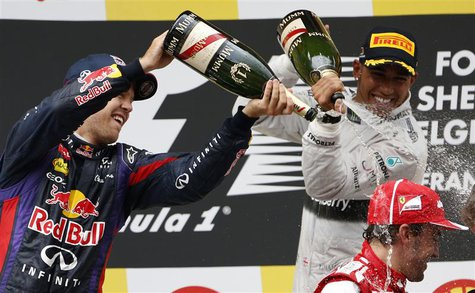 Winner Red Bull Formula One driver Sebastian Vettel of Germany (L) and third-placed Mercedes Formula One driver Lewis Hamilton of Britain (b