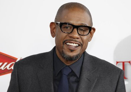 "Actor Forest Whitaker, star of the new film ""Lee Daniels' The Butler,"" poses at the film's premiere in Los Angeles, California August 12, 20"