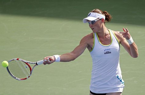 Sam Stosur of Australia hits a return to Jelena Jankovic of Serbia during their women's singles quarter-final match at the WTA Dubai Tennis