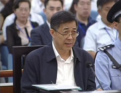 Ousted senior Chinese politician Bo Xilai speaks during his trial in Jinan, Shandong province, August 25, 2013, in this still image taken fr