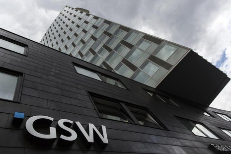 The logo of the GSW property firm is seen at its headquarters in Berlin, August 20, 2013. Deutsche Wohnen offered to buy rival property grou
