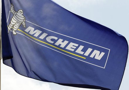 French tyremaker Michelin's flag with a Bibendum, the Michelin Man mascot, is pictured in front of the company's headquarters in Clermont Fe