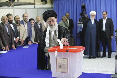 Iran's Supreme Leader Ayatollah Ali Khamenei casts his ballot at his office during the Iranian presidential election in central Tehran June