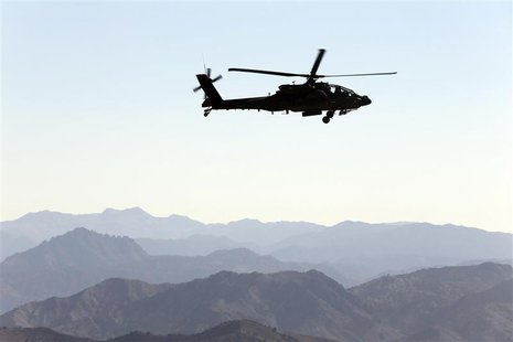 A U.S Army Apache helicopter flies near the town of Walli Was during an operation in Paktika province, near the border with Pakistan Novembe
