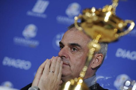 Paul McGinley of Ireland reacts near the Ryder Cup during a news conference after being named the European Ryder Cup captain at the St. Regi
