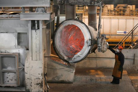A worker operates a mixer of fused aluminium at the foundry shop of the Rusal Sayanogorsk aluminium smelter outside the town of Sayanogorsk,