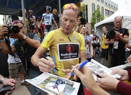 Chris Horner signs autographs before riding in the 82.3-mile Stage-8 of the Amgen Tour of California from Santa Clarita to Thousand Oaks, Ca
