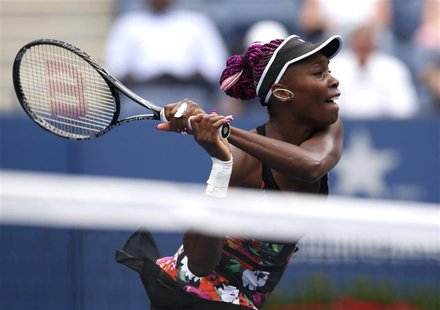 Venus Williams of the U.S. hits a return to Kirsten Flipkens of Belgium at the U.S. Open tennis chammpionships in New York, August 26, 2013.