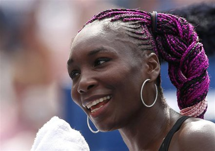 Venus Williams of the U.S. smiles after her victory over Kirsten Flipkens of Belgium at the U.S. Open tennis chammpionships in New York, Aug