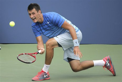 Bernard Tomic of Australia returns to Albert Ramos of Spain at the U.S. Open tennis championships in New York, August 26, 2013. REUTERS/Ray