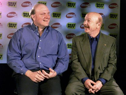 Best Buy Co Inc founder Richard Schulze talks with Microsoft President Steve Ballmer (L) in Redmond, Washington in this December 16,1999 fil