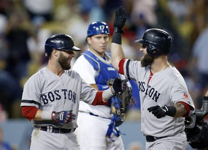 Boston Red Sox's Mike Napoli (R) celebrates after hitting a two-run home run to drive in Dustin Pedroia (L) as Los Angeles Dodgers' catcher
