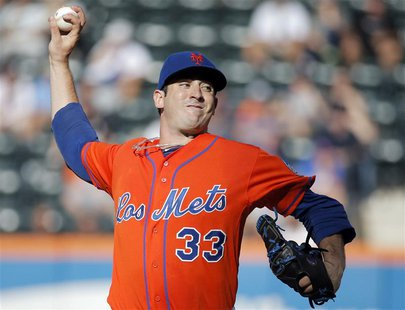 New York Mets starting pitcher Matt Harvey throws a pitch to the Detroit Tigers in the third inning of their MLB inter-league baseball game