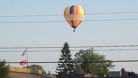 This hot air balloon was spotted over the west side of Kalamazoo Sunday Evening as it lazily floated over the Davenport Campus on West Main.