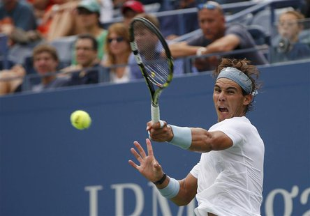 Rafael Nadal of Spain returns to Ryan Harrison of the U.S. at the U.S. Open tennis championships in New York, August 26, 2013. REUTERS/Mike