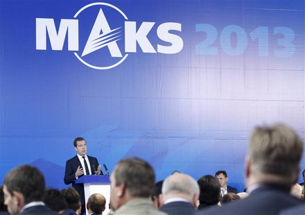 Russia's Prime Minister Dmitry Medvedev (L, back) addresses participants during a meeting opening the MAKS International Aviation and Space