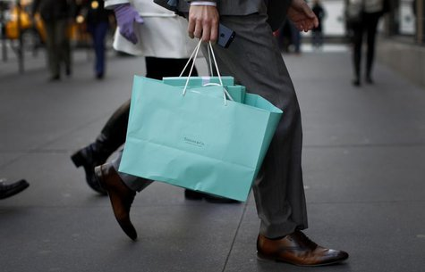 A shopper carries bags from Tiffany & Co. jewelers along 5th Avenue in New York City, April 4, 2013. REUTERS/Mike Segar