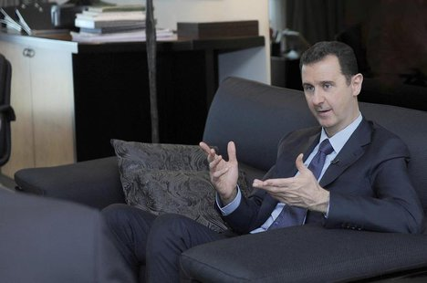 Syria's President Bashar al-Assad speaks during an interview with a Russian newspaper in Damascus, in this handout photograph distributed by
