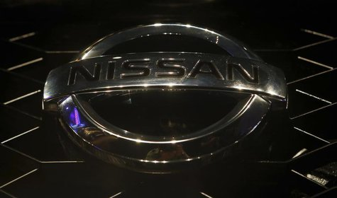 "A company logo is seen on the newly-unveiled Nissan ""Terrano"" compact sport utility vehicle during a news conference in Mumbai August 20, 20"