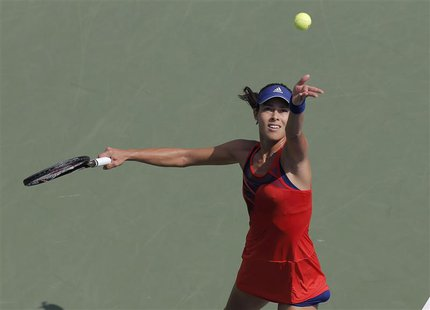 Ana Ivanovic of Serbia serves to Anna Tatishvili of Georgia at the U.S. Open tennis championships in New York August 27, 2013. REUTERS/Ray S