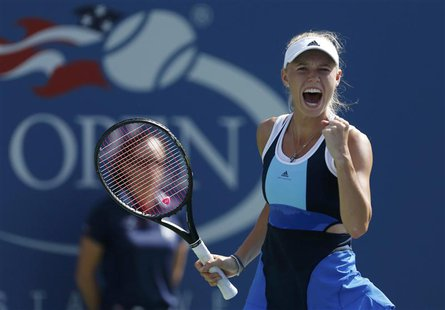 Caroline Wozniacki of Denmark celebrates after winning match point against Duan Ying-Ying of China at the U.S. Open tennis championships in