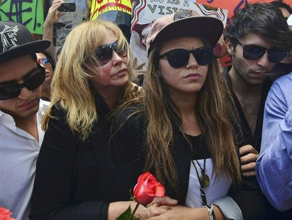 Jacqueline Llach (center L), the mother of graffiti artist Israel Hernandez-Llach, who died after being shocked by a police officer's Taser,