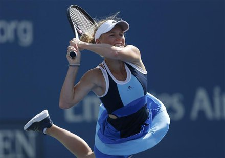Caroline Wozniacki of Denmark returns to Duan Ying-Ying of China at the U.S. Open tennis championships in New York August 27, 2013. REUTERS/