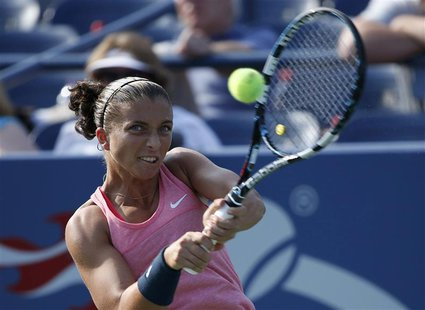 Sara Errani of Italy hits a return to Olivia Rogowska of Australia at the U.S. Open tennis championships in New York August 27, 2013. REUTER