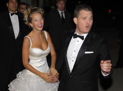 Canadian singer Michael Buble and his bride Argentine actress Luisana Lopilato pose for photographers after their religious wedding ceremony