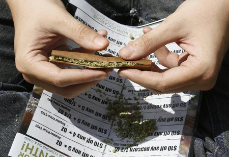 A participant rolls a marijuana filled blunt at the 4/20 marijuana holiday in Civic Center Park in downtown Denver April 20, 2013. REUTERS/R