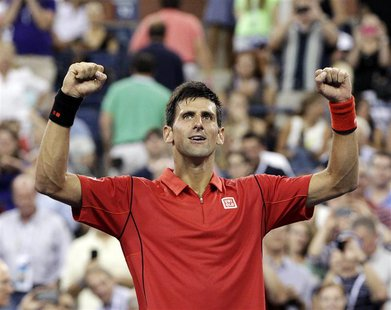 Novak Djokovic of Serbia celebrates defeating Ricardas Berankis of Lithuania during their first round match at the U.S. Open tennis champion