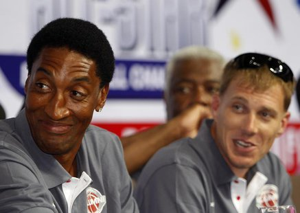 Former NBA Chicago Bulls player Scottie Pippen (L) smiles during a news conference inside a mall of Asia Arena in Manila, July 17, 2012. REU
