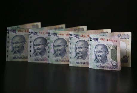 Indian Rupee notes are seen in this picture illustration taken in Mumbai June 12, 2013. REUTERS/Vivek Prakash