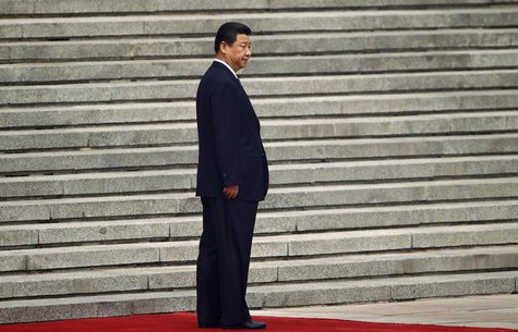 China's President Xi Jinping waits for his Palestinian counterpart Mahmoud Abbas before a welcoming ceremony outside the Great Hall of the P
