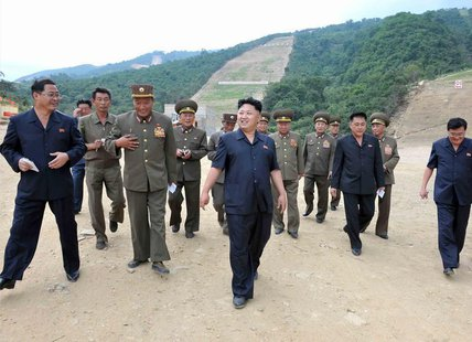 North Korea's leader Kim Jong-un (front C) visits the construction site of a ski resort being built on Masik Pass in this undated photo rele