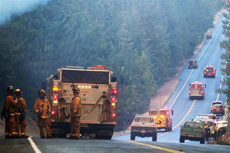 Fire crews line up along Highway 120 at the Rim Fire in this undated United States Forest Service handout photo near Yosemite National Park,