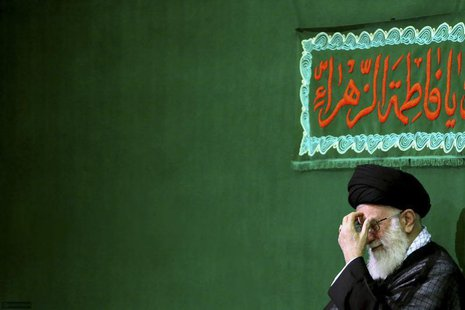 Iran's Supreme Leader Ayatollah Ali Khamenei reacts while attending a religious ceremony to commemorate the death anniversary of Fatima, dau