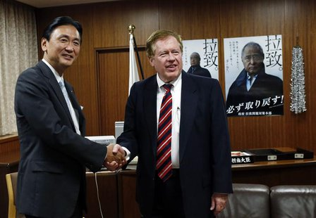 Robert King (R), U.S. special envoy for North Korean human rights issues, meets with Japan's Minister-in-Charge of the Abduction Issue and h